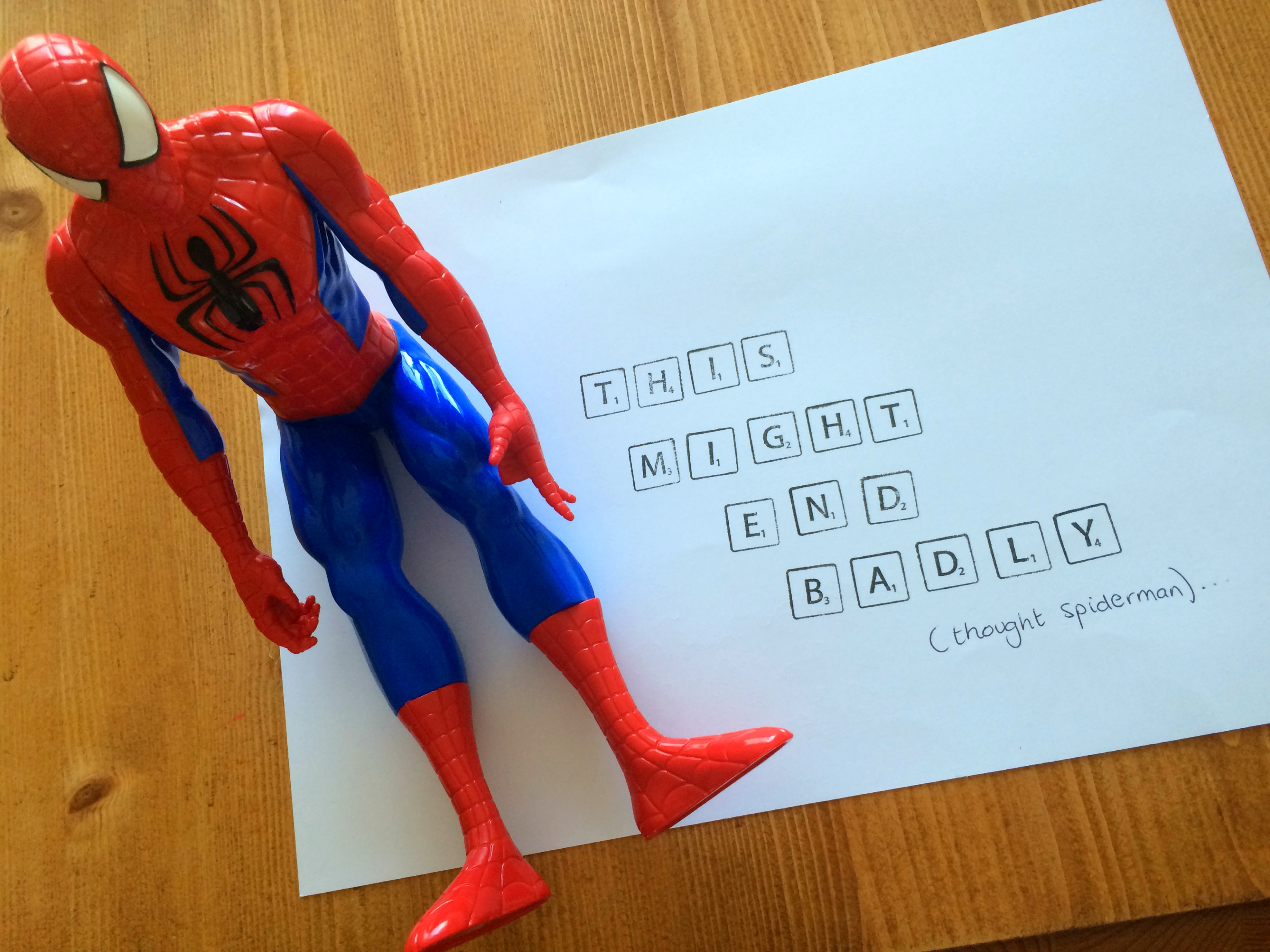 Photo of a Spiderman action figure sitting my a note that says, this might end badly.